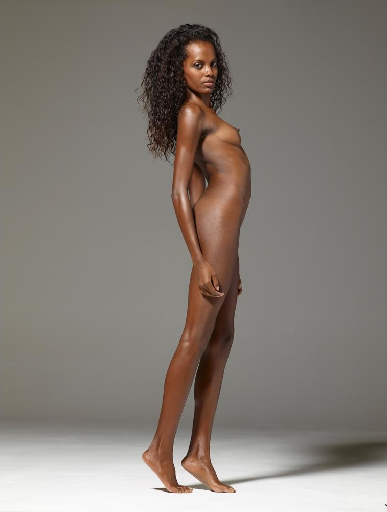 Naked ebony woman spreading legs